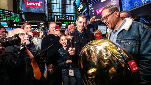 Chip Bergh, president and chief executive officer of Levis Strauss & Co., center, rings a ceremonial bell as Harmit Singh, executive vice president and chief financial officer of Levi Strauss & Co, right, smiles during the company's initial public offering (IPO) on the floor of the New York Stock Exchange (NYSE) in New York on Thursday, March 21, 2019.