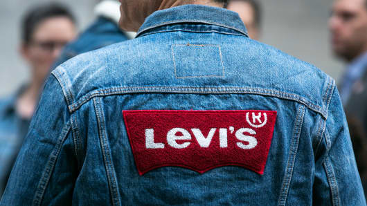 A man wears Levis Strauss & Co. clothing during the company's initial public offering (IPO) at the New York Stock Exchange (NYSE) in New York, U.S., on Thursday, March 21, 2019.