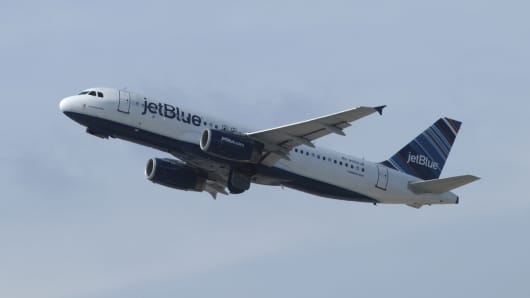 A jetBlue Airways airplane takes off from Newark Liberty Airport on September 30, 2018 as seen from Elizabeth, New Jersey.