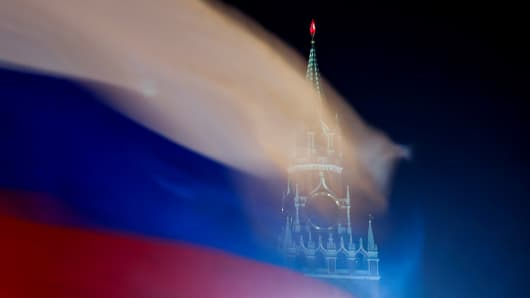 Russian flag flies with the Spasskaya Tower of the Kremlin in the background in Moscow, Russia, February 27, 2019.