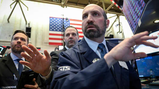Traders work on the floor at the New York Stock Exchange, March 22, 2019.