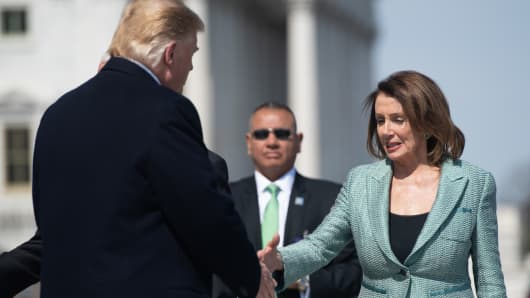 US President Donald Trump shakes hands with Speaker of the House Nancy Pelosi as he departs following the Friends of Ireland Luncheon in honor of Irish Prime Minister Leo Varadkar at the US Capitol in Washington, DC, March 14, 2019.