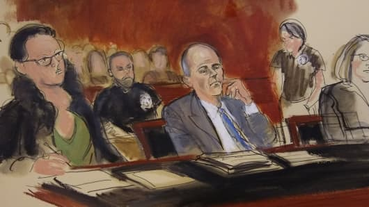 A court sketch of Michael Avenatti seated at defense table with his attorney Federal Defender Sylvie Levin.