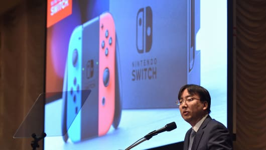 Japan's video game company Nintendo President Shuntaro Furukawa delivers a speech during a briefing of the company's financial results in Tokyo on February 1, 2019.
