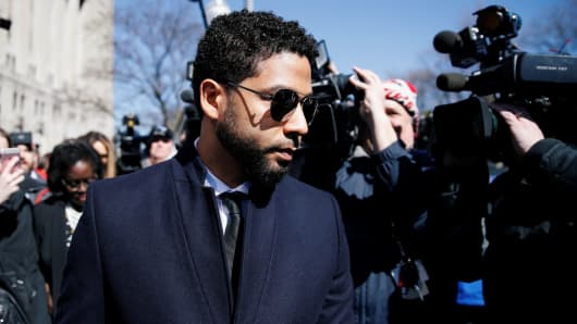 Actor Jussie Smollett leaves court after charges against him were dropped by state prosecutors in Chicago, Illinois, March 26, 2019.
