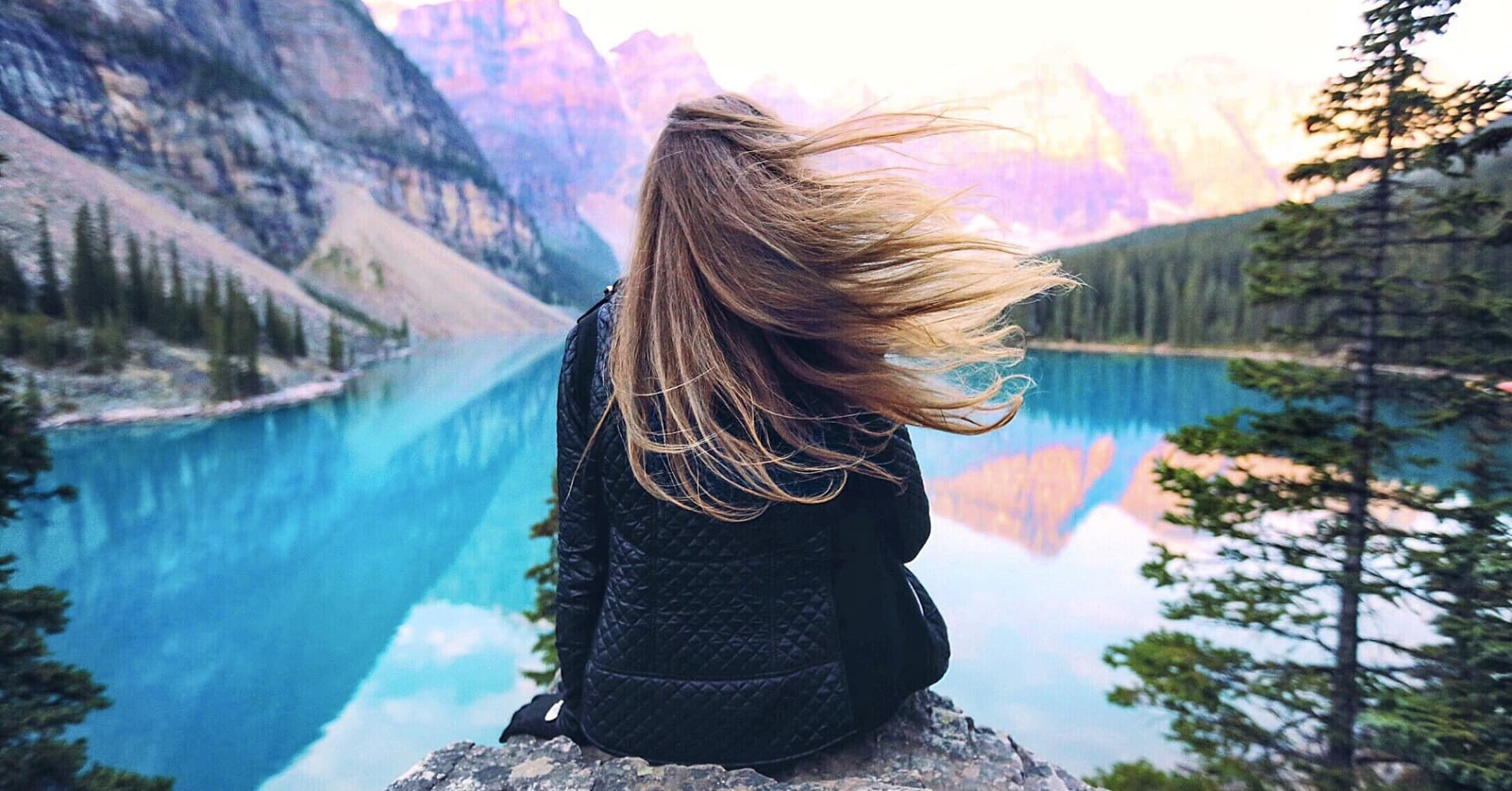 Woman overlooking Moraine Lake in Canada.