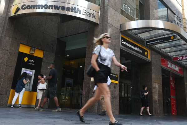 Pedestrians walk past a Commonwealth Bank of Australia branch in Sydney, Australia, on Wednesday, Feb. 6, 2019.