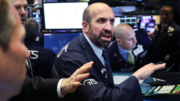 Traders work on the floor of the New York Stock Exchange on March 22, 2019.