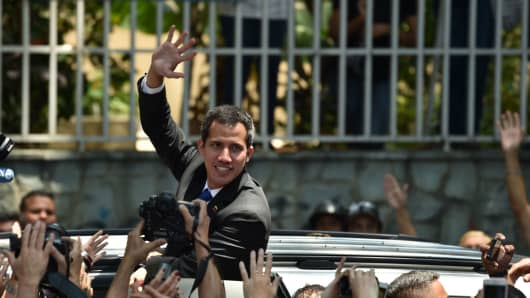 Venezuelan opposition leader and self-proclaimed interim president Juan Guaido waves supporters after giving details of what he calls 'Operation Freedom' during a rally with local and regional leaders, in Caracas on March 27, 2019.
