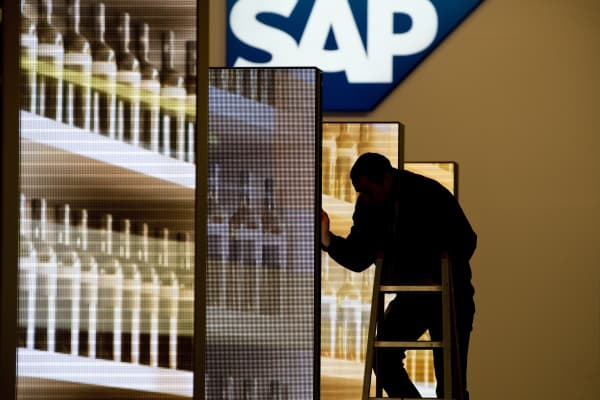A member of staff adjusting screens at the SAP office.