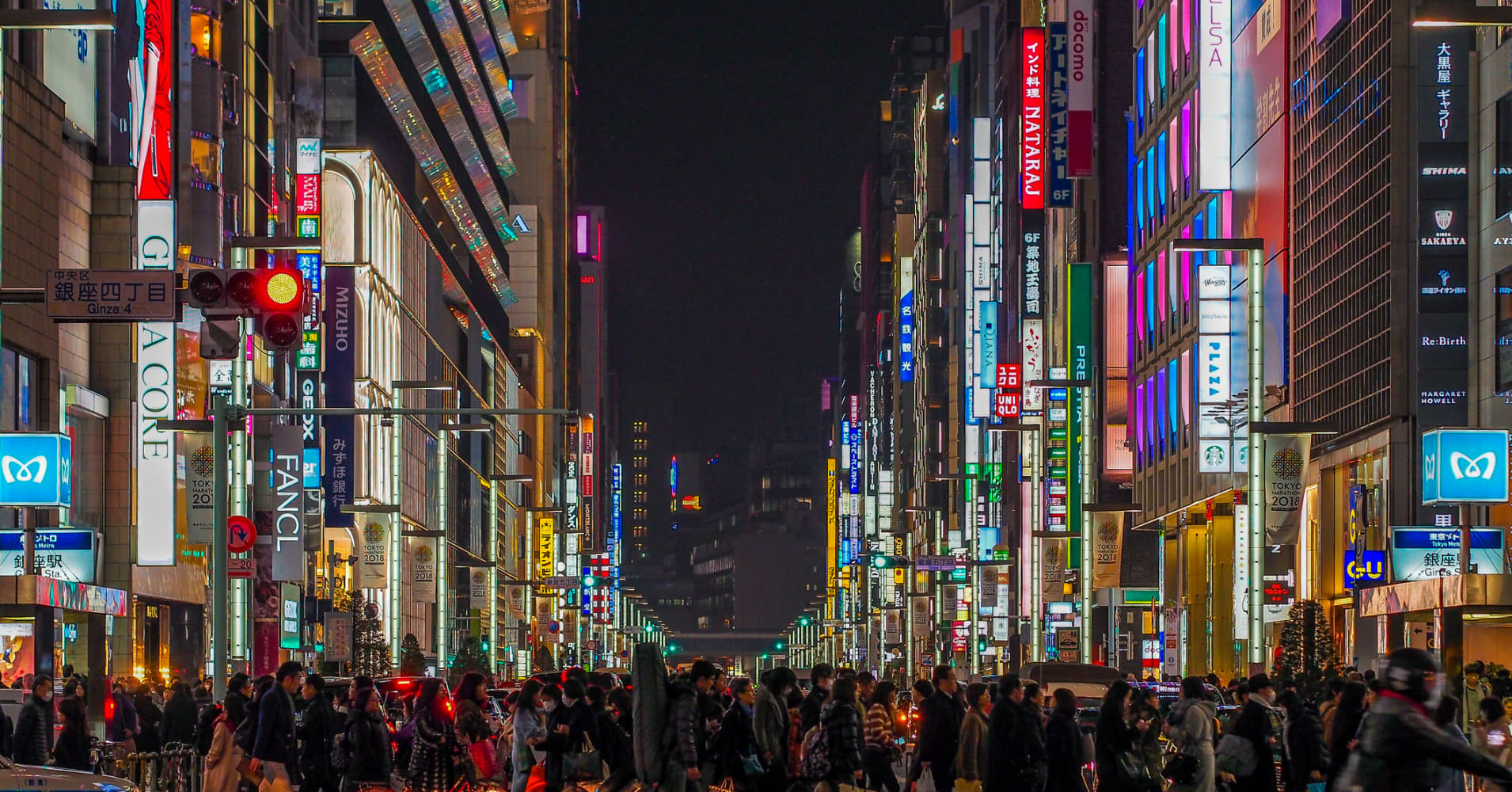 Top luxury shopping streets with multi colored neon signs in Tokyo, Japan.