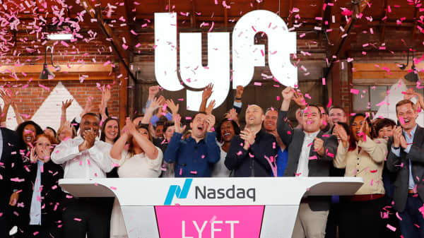 Lyft President John Zimmer and CEO Logan Green applaud as Lyft lists on the Nasdaq at an IPO event in Los Angeles March 29, 2019.