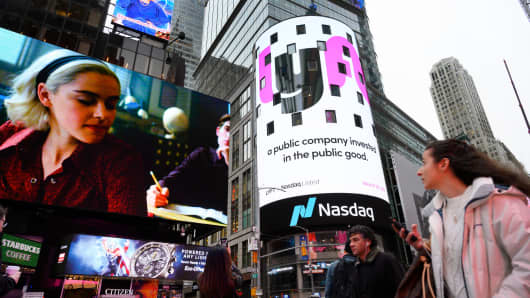 The Lyft logo is shown on the screen at the Nasdaq offices in Times Square on March 29, 2019 in New York.