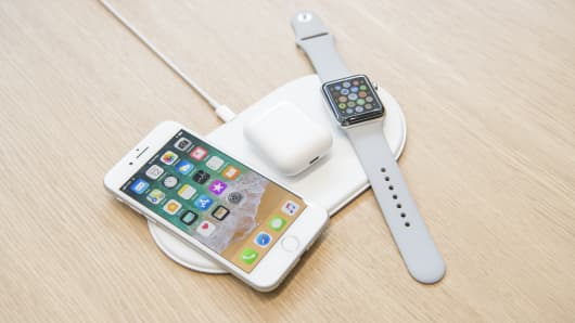 The Apple Inc. iPhone 8, Airpods, and Apple Watch sit on the AirPower charger during an event at the Steve Jobs Theater in Cupertino, California, U.S., on Tuesday, Sept. 12, 2017.
