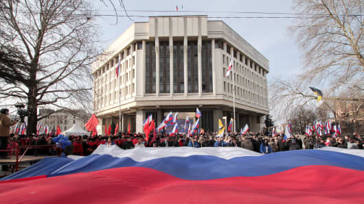 People take part in celebrations of the fifth anniversary of Russia's annexation of Crimea in Simferopol, Crimea March 15, 2019.