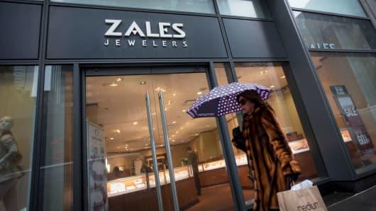 A pedestrian walks past a Zales store in New York.