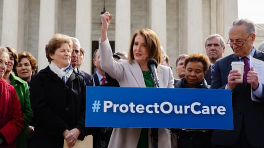 U.S. House Speaker Nancy Pelosi, a Democrat from California, center, speaks during an event with House and Senate Democrats on protecting the Affordable Care Act outside the Supreme Court Building in Washington, D.C., on Tuesday, April 2, 2019.
