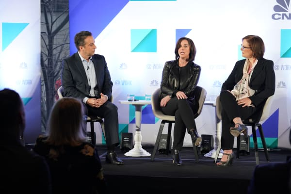 Adam Bryant moderates a panel discussion with Donna Morris (left) and Kathleen Hogan during the @Work event in New York City on April 2, 2019.