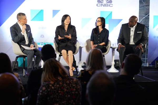 Craig Robinson moderates a panel discussion with (L to R) Amy Liu Abel, Nancy Reyes and Eric Hutcherson during the @Work event in New York City on April 2, 2019.