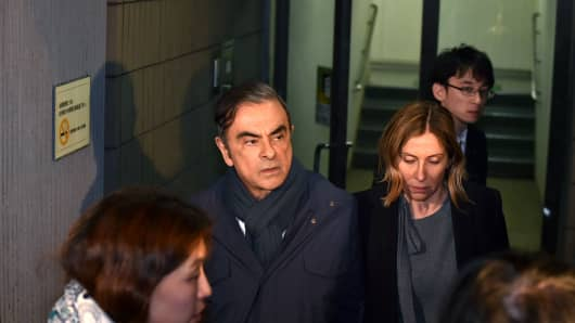 Former Nissan Chairman Carlos Ghosn and his wife Caroleleave the office of his lawyer Junichiro Hironaka in Tokyo on April 3, 2019.
