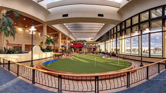 8-hole putting green at the Palm Beach International Airport.