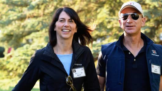 Jeff Bezos, founder and CEO Amazon.com, and his wife Mackenzie Bezos arrives for the Allen & Co., arrives to the Allen & Co. annual conference  July 12, 2013 in Sun Valley, Idaho.