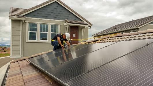PetersenDean says it will need some 400 additional solar installers like Ruben Trujillo by year's end, due to a new California mandate.