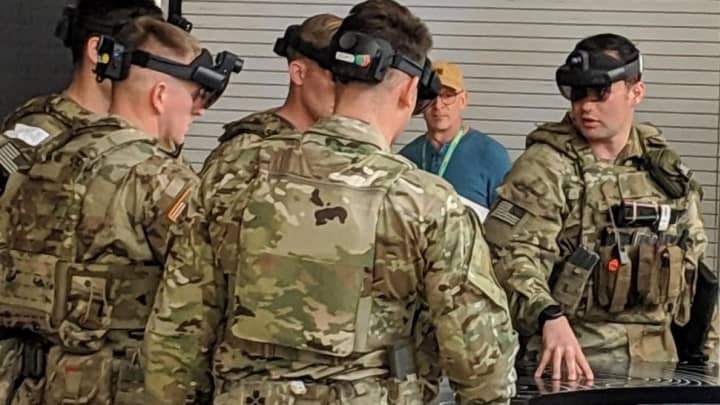 Soldiers wearing the IVAS system, a modified version of the HoloLens 2.