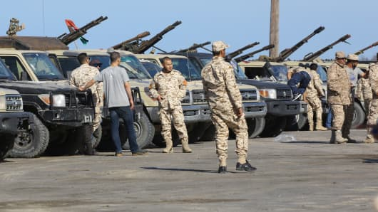 Forces loyal to Libya's UN-backed unity government arrive in Tajura, a coastal suburb of the Libyan capital Tripoli, on April 6, 2019, from their base in Misrata.
