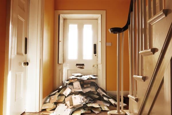 Pile of post by front door (digital composite)