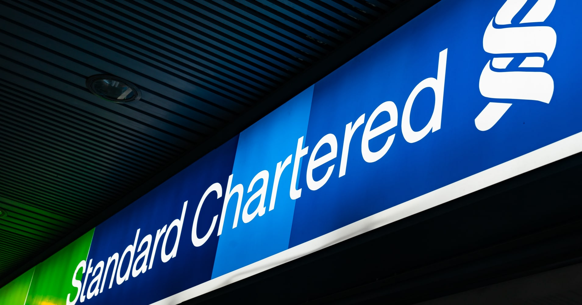 Standard Chartered expected to pay just over $1 billion to resolve US, UK probes