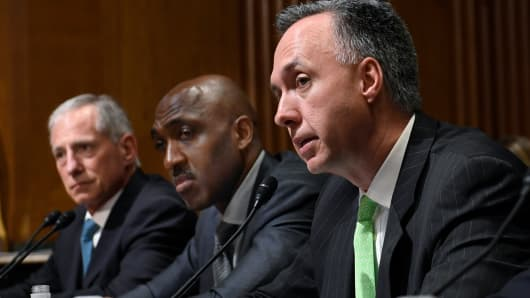 Humana Healthcare Services Segment President William Fleming, right, testifies before the Senate Finance Committee on Capitol Hill in Washington, Tuesday, April 9, 2019, during a hearing to explore the high cost of prescription drugs.