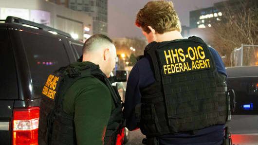 HHS Office of Inspector General agents, take part in arrests Tuesday, April 9, 2019, in Queens, N.Y., as they break up a billion-dollar Medicare scam that peddled unneeded orthopedic braces to hundreds of thousands of seniors nationwide, using a network of foreign call centers.