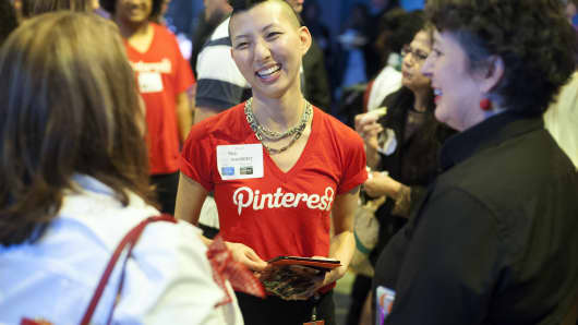 A Pinterest employee speaks with attendees during a Pinterest media event at the company's corporate headquarters office in San Francisco.