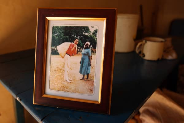 A family photograph of Barack Obama with his step-grandmother Sarah Obama on a 1987 visit to Kenya stands on a table in her house on January 12, 2008 in Kogelo, western Kenya.