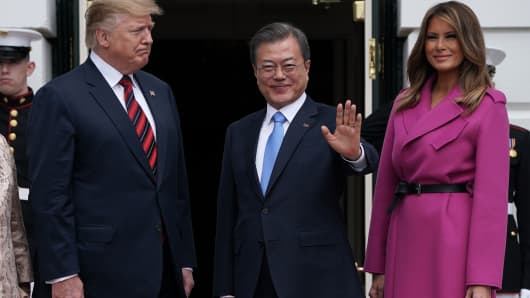 U.S. President Donald Trump and first lady Melania Trump welcome South Korean President Moon Jae-in to the White House April 11, 2019 in Washington, DC.