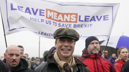 Former UKIP leader Nigel Farage takes part in a pro-Brexit march.