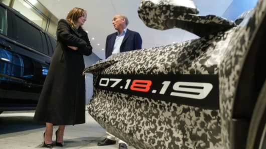 General Motors Chairman and CEO Mary Barra and Chevrolet Corvette Chief Engineer Tadge Juechter Thursday, April 11, 2019 with a camouflaged next generation Chevrolet Corvette in New York, New York.