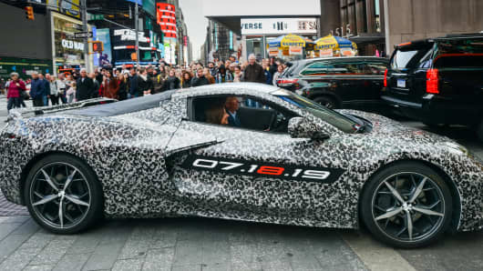 Chevrolet Corvette Chief Engineer Tadge Juechter and General Motors Chairman and CEO Mary Barra drive in a camouflaged next generation Corvette down 7th Avenue near Times Square Thursday, April 11, 2019 in New York, New York.