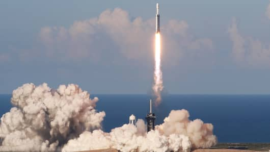 A SpaceX Falcon Heavy Rocket, carrying the Arabsat 6A communications satellite, lifted off from the Kennedy Space Center in Cape Canaveral, Florida, April 11, 2019.