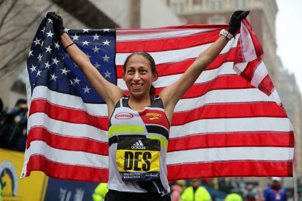 2018 Boston Marathon women's winner Desiree Linden celebrates after she crosses the finish line