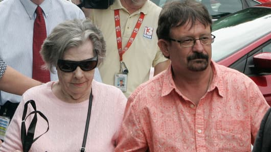 Powerball winner Gloria C. Mackenzie, 84, left, leaves the lottery office escorted by her son, Scott Mackenzie, after claiming a single lump-sum payment of about $370.9 million before taxes on Wednesday, June 5, 2013, in Tallahassee, Fla.