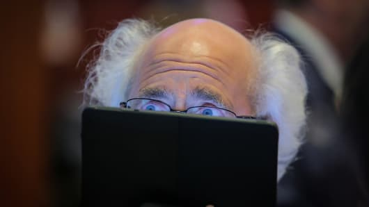 A trader works on the floor at the New York Stock Exchange (NYSE) in New York, U.S., April 8, 2019.