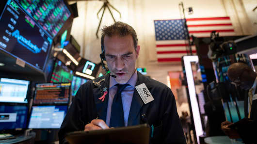 A trader works ahead of the closing bell on the floor of the New York Stock Exchange (NYSE) on April 12, 2019 in New York City.