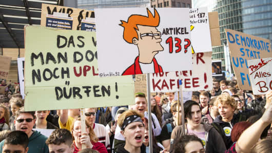 People attend a demonstration against Article 13 of the planned EU reform of copyright.