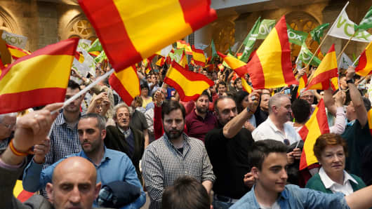 Supporters of Spain's far-right Vox party wave Spanish flags during a campaign rally in Burgos, northern Spain on April 14, 2019, ahead of the April 28 general elections.
