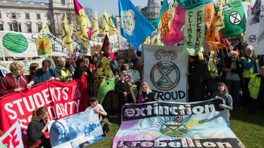Environmental activists from Extinction Rebellion kick-off a day of action in Parliament Square with a colourful display of flags and banners, demanding creation of Citizens Assembly to propose effective ways for the UK to become carbon-neutral by 2025, on 15 April, 2019 in London, England.