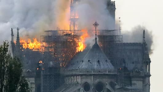 Flames rise during a fire at the landmark Notre-Dame Cathedral in central Paris on April 15, 2019 afternoon, potentially involving renovation works being carried out at the site, the fire service said.