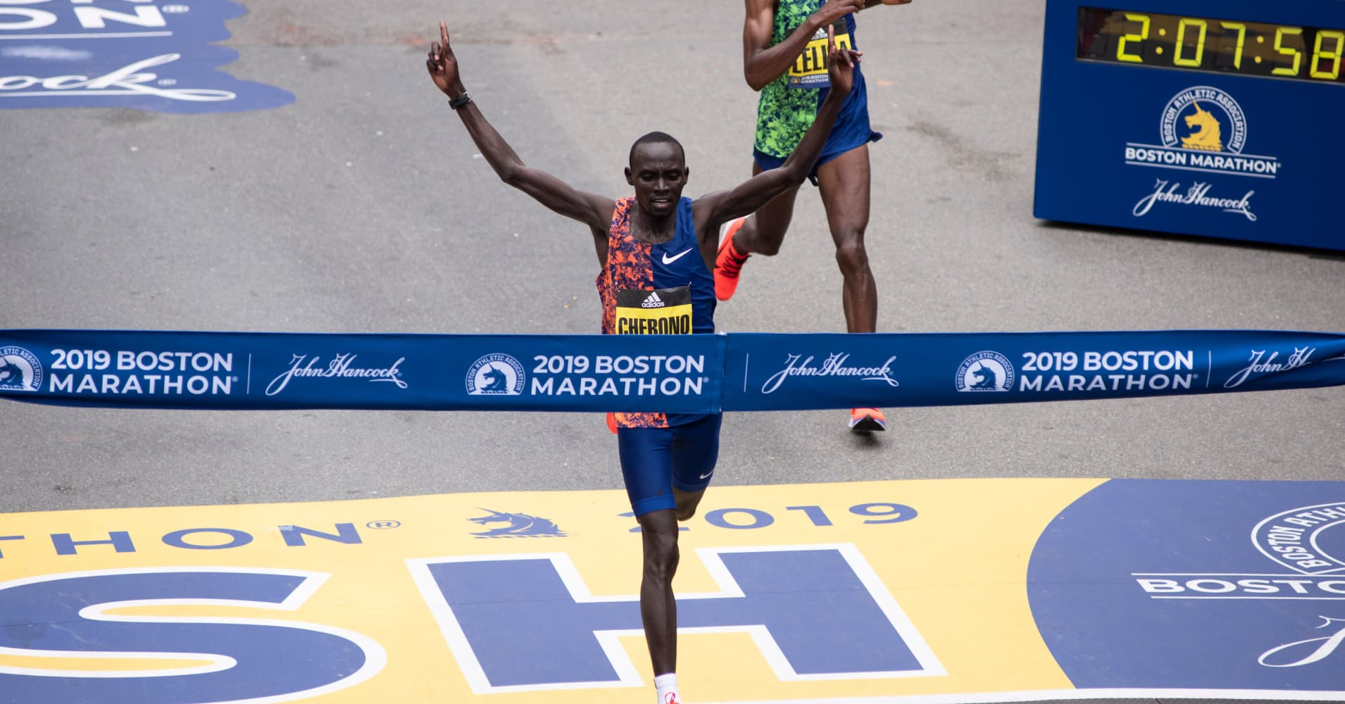 Kenyan Lawrence Cherono edges Ethopian Lelisa Desisa for first place for the Men's Elite race, at the 123rd Boston Marathon on April 15, 2019