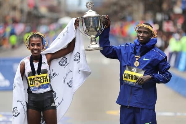 Men's Winner Lawrence Cherono and Women's Winner Worknesh Degefa will retain trophies at the targeting ceremony at the 123rd Boston Marathon